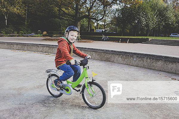 Portrait of smiling little boy riding bicycle