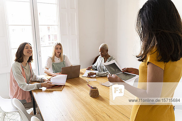 Businesswoman leading a presentation in office