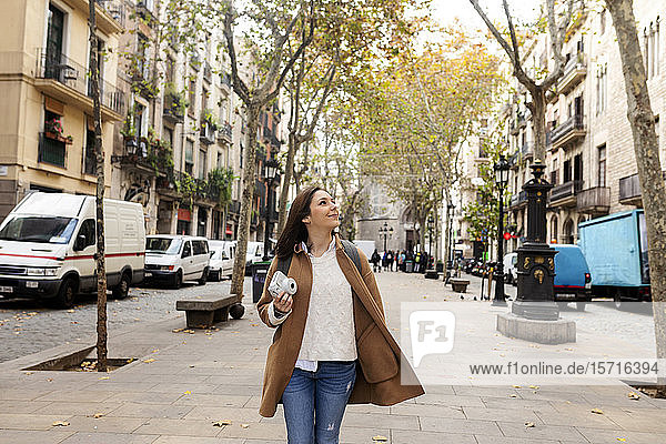 Young woman exploring the city  Barcelona  Spain