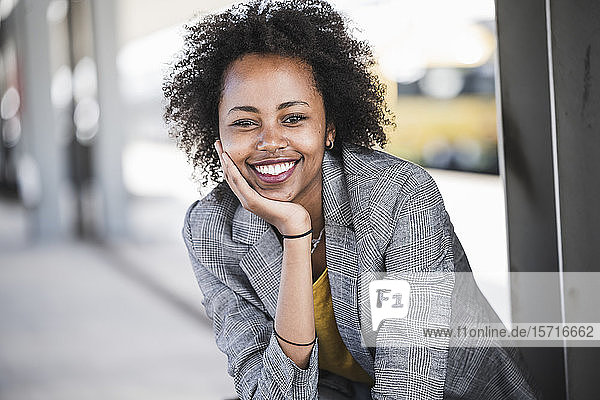 Portrait of smiling young businesswoman at the train station