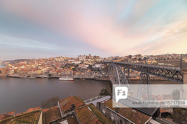 Portugal  Porto District  Porto  Sky over city buildings surrounding Douro river and Dom Luis I Bridge at dawn