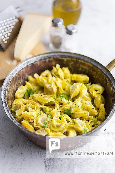 Pan of Italian tortellini withgranacheese