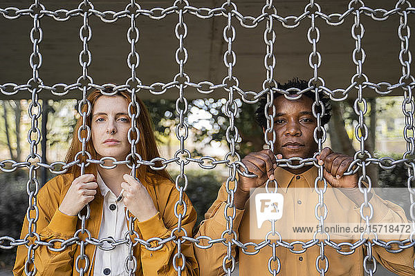 Couple behind chains