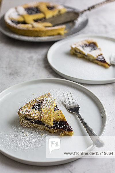 Slice of homemade pie with plum jam