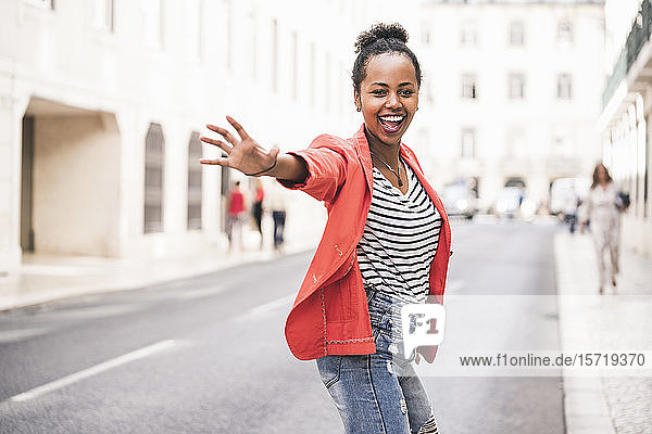 Portrait of happy young woman in the city  Lisbon  Portugal