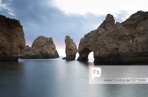 Portugal  Faro District  Lagos  Natural arch and coastal rock formations at dawn