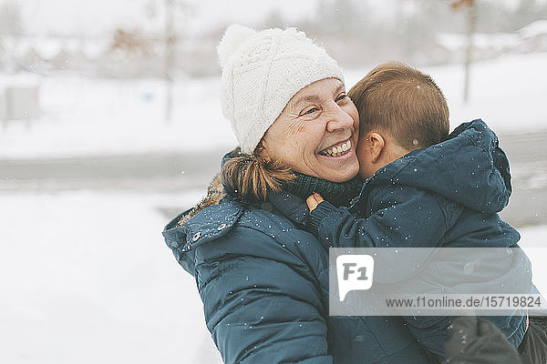 Grandmother and grandson hugging each other
