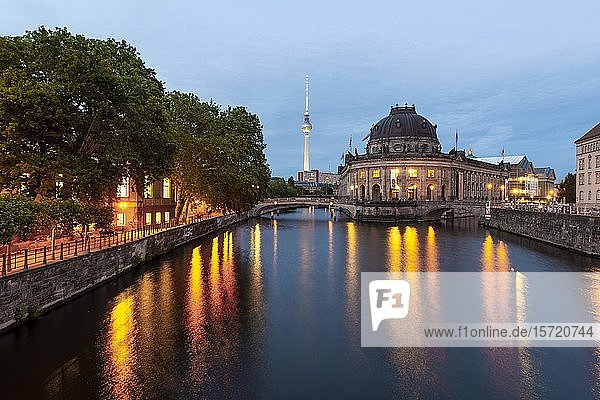 Evening mood  illuminated Bode Museum on the Spree  in the back Berlin television tower Alex  Museum Island  Berlin-Mitte  Berlin  Germany  Europe