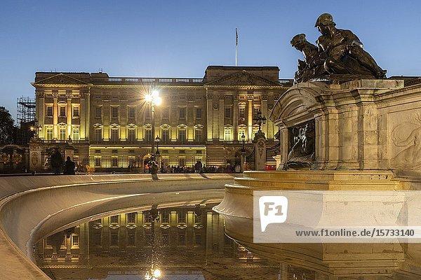 Buckingham Palace at night London England.