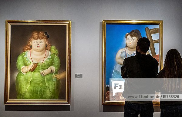 At left `Mujer con pájaro' and at right `Mujer pequeña' both by Fernando Botero  Botero Museum  Bogota  Colombia.