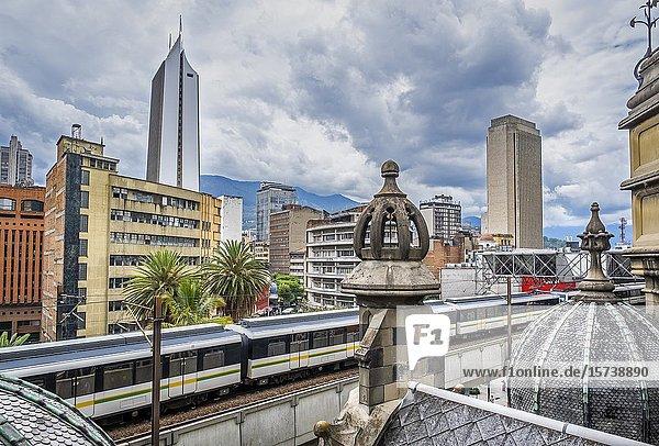 Metro  subway  A line between Prado station and Hospital station  city center  skyline  Medellín  Colombia.
