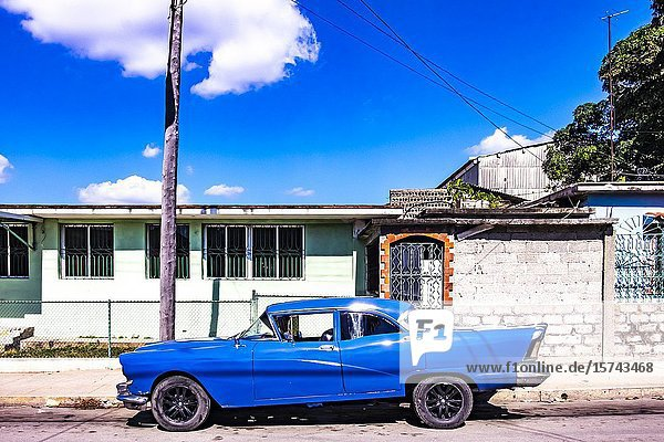 Classic car in the streets of Cienfuegos  Republic of Cuba  Caribbean  Central America.