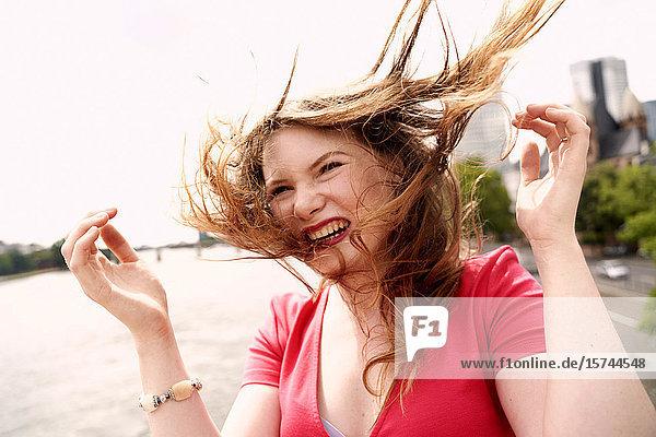 Portrait of happy young woman. Frankfurt am Main. Germany.