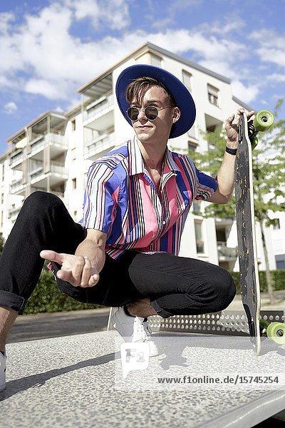 Man with skateboard. Munich  Germany.