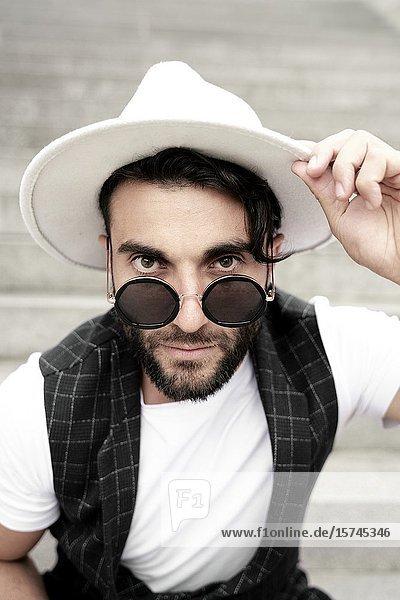 Portrait of man wearing hat.