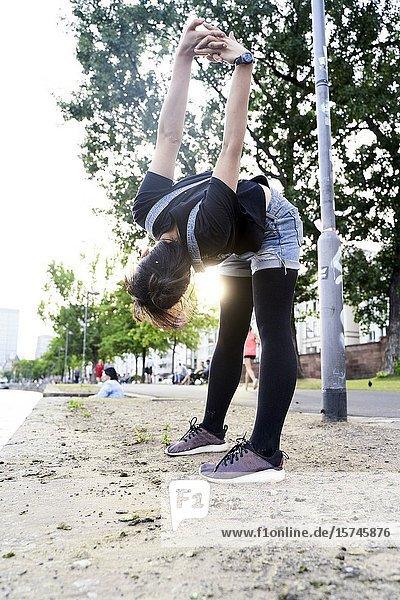 Korean woman stretching. Frankfurt am Main  Germany.