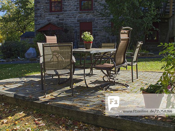 Table and chairs on stone patio  Carleton Place  Ontario  Canada.