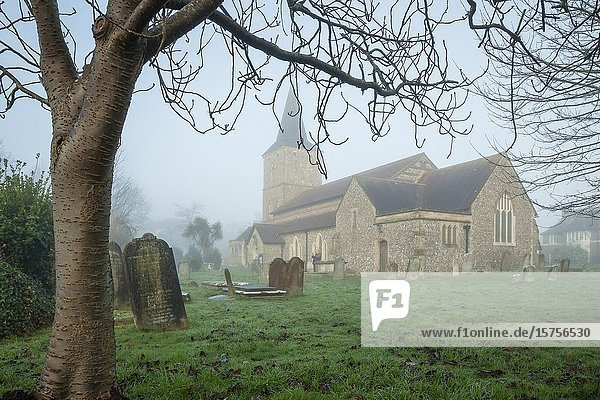 Foggy winter morning at St Michael's church in Southwick  West Sussex  England.