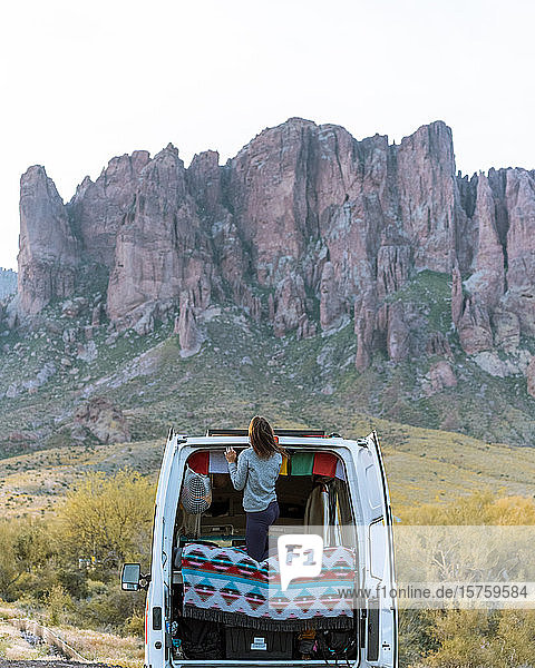 Woman in off road vehicle  Superstition mountains in background  Arizona  United States
