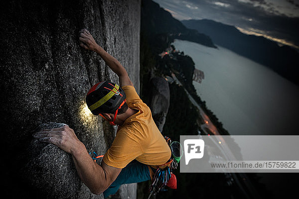 One person trad climbing at night  view to the landscape below Squamish  British Columbia  Canada