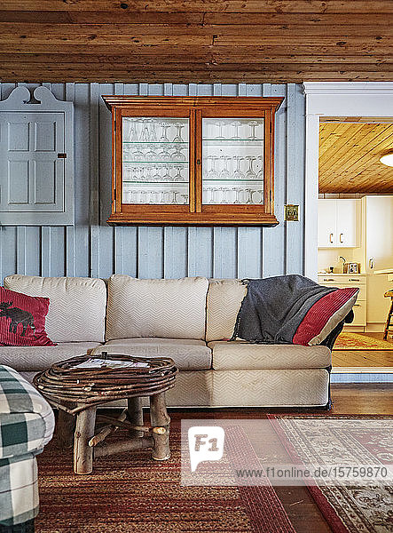 The living room in a cottage or cabin.