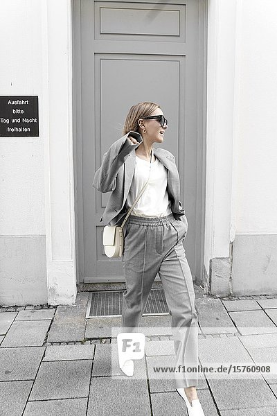 Fashionable woman in gray suit. Munich  Germany.