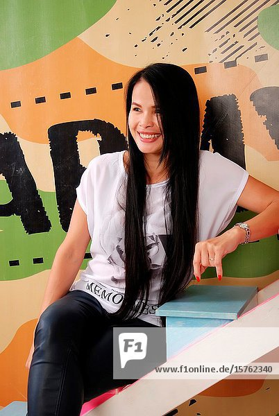 Asian woman with long hairs.