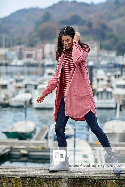 Mid-adult woman  Marina  Pasai Donibane  Pasaia Port  Gipuzkoa  Basque Country  Spain  Europe