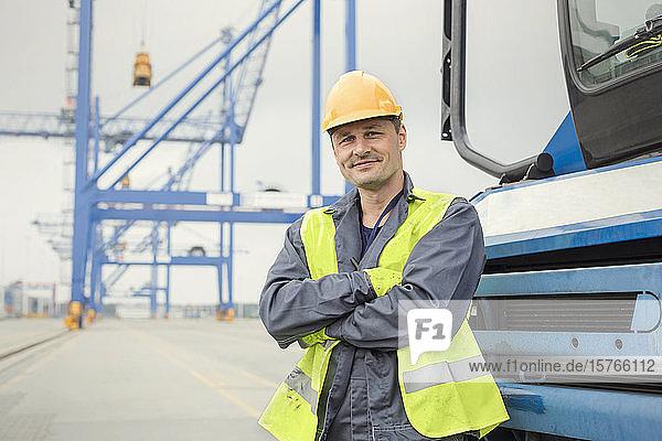 Portrait confident dock worker at shipyard