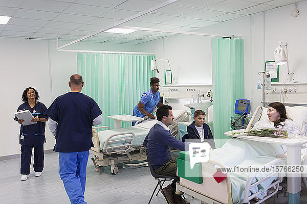 Doctors  nurses  patients and visitors in hospital ward