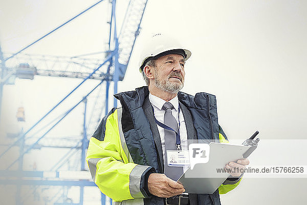 Dock manager with clipboard at shipyard