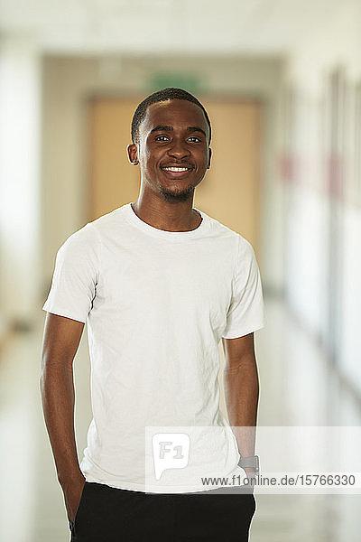 Portrait confident young man in corridor