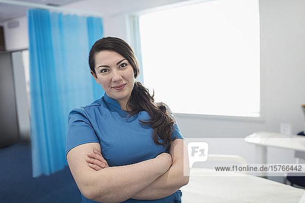 Portrait confident female nurse in hospital room Portrait confident female nurse in hospital room