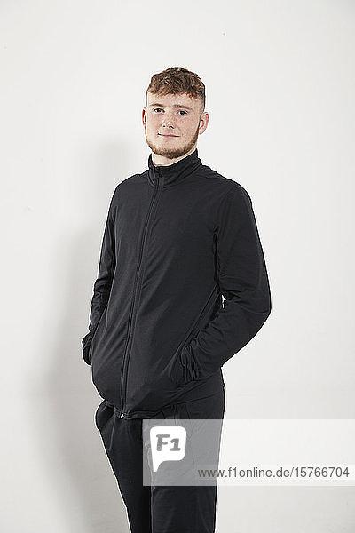 Portrait confident young man in black jacket