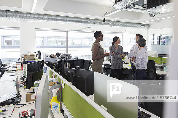Business people talking  meeting in open plan office