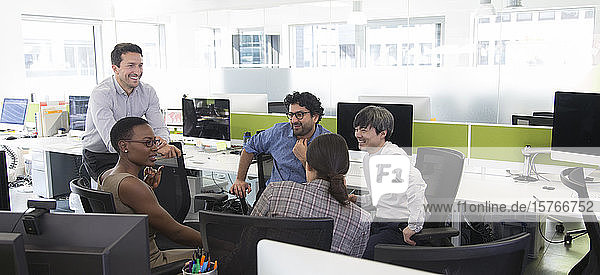 Business people meeting in open plan office