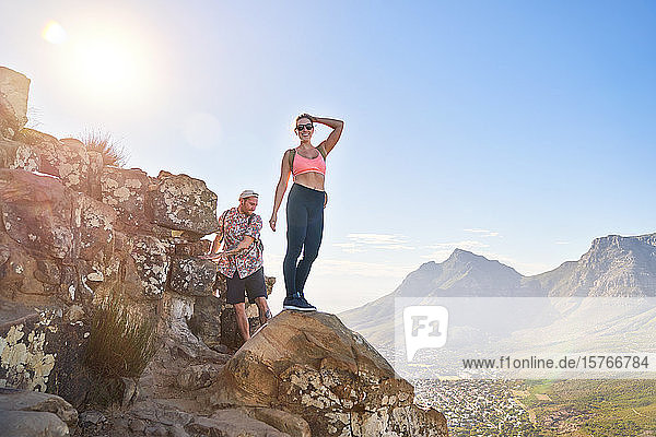 Portrait happy young woman hiking sunny cliff Cape Town South Africa Portrait happy young woman hiking sunny cliff Cape Town South Africa