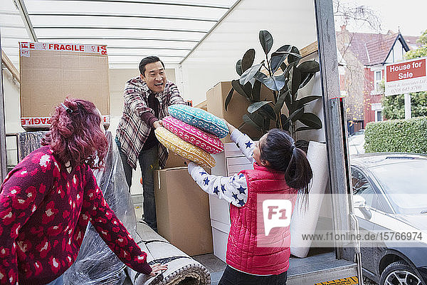 Friends moving  unloading moving van