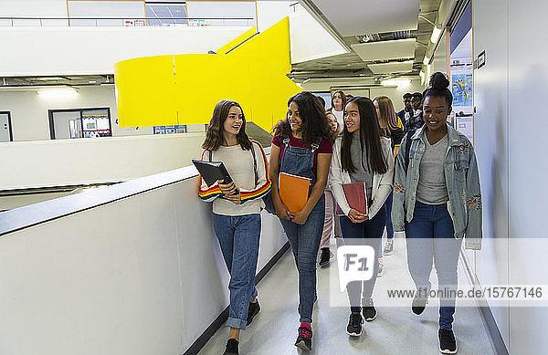 Junior high girl students walking in corridor Junior high girl students walking in corridor
