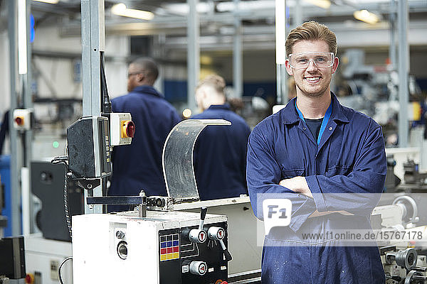 Portrait confident young male college student in shop class