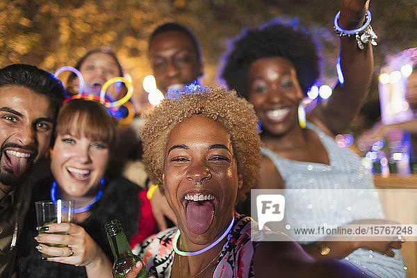 Portrait happy  exuberant friends cheering at garden party