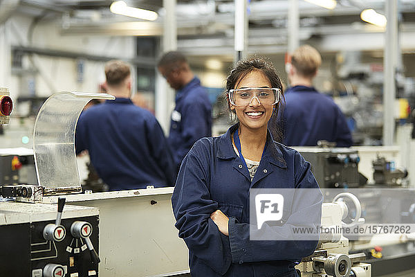 Portrait confident young female college student in shop class