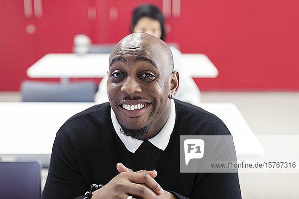 Portrait happy  confident male community college student in classroom