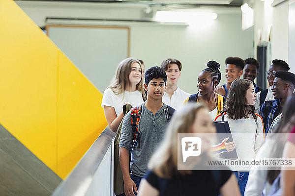Junior high students walking in corridor
