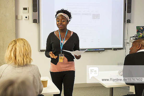 Female community college instructor leading lesson in classroom