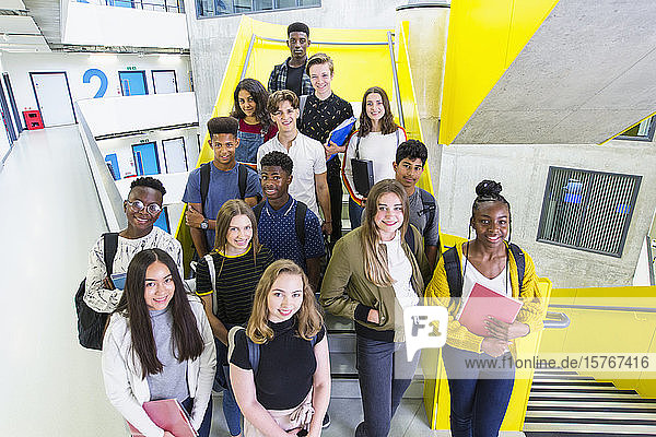 Portrait confident junior high students on stairs Portrait confident junior high students on stairs
