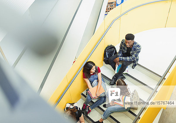 Junior high students talking on stairs