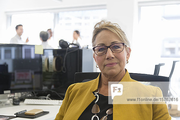 Portrait confident businesswoman in office