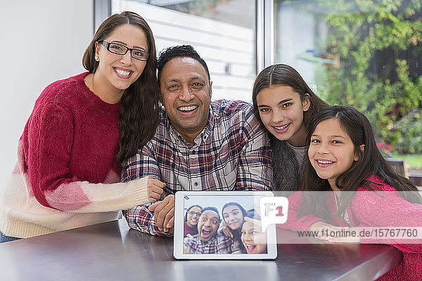 Portrait happy family with digital tablet selfie