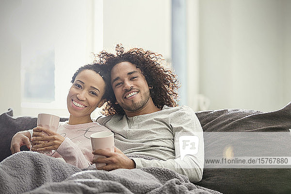 Portrait smiling  affectionate couple relaxing on sofa